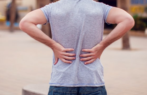 Back pain and stiffness in the lower spine